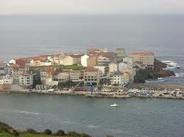 Zarra, sardinas en el puerto de Caión
